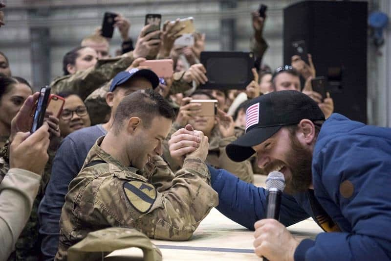Captain America actor Chris Evans challenged a serviceman to an arm wrestling match during 2016 USO Holiday Tour.