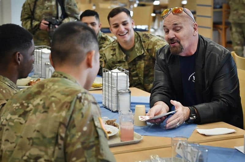Illusionist Jim Karol performed card tricks for service members during 2016 USO Holiday Tour at the Tower Barracks Dining Facility, Grafenwoehr, Germany.