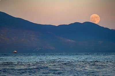 Supermoon rising over Gulf of Corinth, Greece